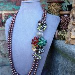Beautiful handmade gemstone flowers and luminous pearls.