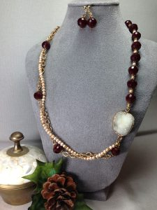Beautiful druzy pendant paired with goldtone vintage chain and candy apple red faceted crystals.